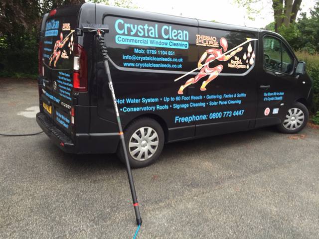 Side view of Crystal Clean Van